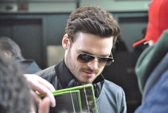 Richard Madden. New york city, new york march 9 2015: fans wait anxiously for richard madden, so they can have their pictures taken with him, and so he can sign royalty free stock image