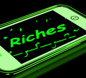 Riches On Smartphone Showing Wealth Stock Images