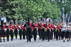 Richfield High School Marching Band in a Parade. OSSEO, MN - JUNE 26 : Richfield High School Marching Band Performing in the Osseo Marching Band Festival on June Stock Photography