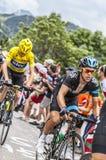 Richie Porte und Chris Froome Climbing Alpe D'Huez Lizenzfreie Stockfotos