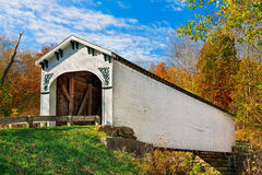 Richland Creek Covered Bridge. The Richland Creek Covered Bridge in rural Greene County Indiana is surrounded by colorful fall foliage on a sunny autumn day Stock Photos