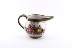 Richly decorated bowl with a handle Royalty Free Stock Photography