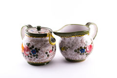 Richly decorated bowls with a handle Royalty Free Stock Photography