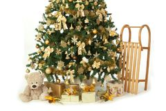 Richly decorated christmas tree with golden ornaments  isolated. Richly decorated christmas tree with golden ornaments studio shoot isolated white background Royalty Free Stock Photo