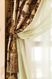 Richly decorated curtain with a holding strap Stock Photography