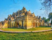 The corner of old Maha Aungmye Bonzan Monastery, Ava, Myanmar. The richly decorated old building of Maha Aungmye Bonzan Monastery, famous for its architectural royalty free stock image
