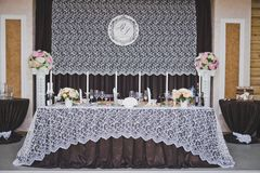 Richly decorated with viands and decorated dining table 8920. Stock Image