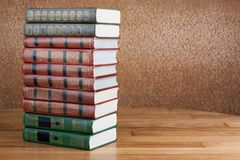 Richly decorated volumes of books with a gold lettering Royalty Free Stock Images
