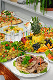 Richly served banquet table. With excess of dishes Royalty Free Stock Images