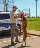 Richmond, KY US - March 31, 2018 - Easter Eggstravaganza A K9 Officer demonstrates canine techniques and training exercises stock photos