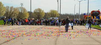 Richmond, KY US - March, 31 2018 - Easter Eggstravaganza - Kids line up as adults spread out plastic eggs before an egg hunt stock images