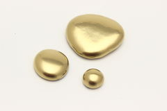 Gold Pebble contemplation of richness Royalty Free Stock Photos