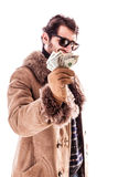 Richness. A young man wearing a sheepskin coat isolated over a white background holding banknotes Stock Images