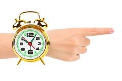 Richtend hand en wekker zoals een horloge Royalty-vrije Stock Foto's