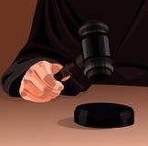 Richterhand mit Hammer stockfoto
