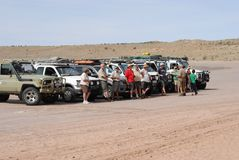 Richtersveld 4x4 tour. Cars, drivers and their families and friends lined up for a group photograph Royalty Free Stock Photos