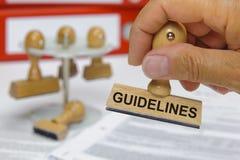 Richtlinien markiert auf Stempel lizenzfreies stockfoto