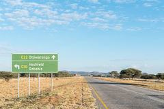 Richtungszeichen auf dem C22-road Lizenzfreies Stockbild