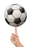 Ricicli la sfera di calcio di carta su un dito indice Fotografia Stock