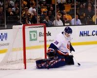 Rick DiPietro New York Islanders. New York Islanders goalie Rick DiPietro makes a pad save against the Boston Bruins stock photos