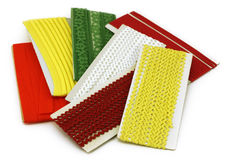 Rick Rack and Other Sewing Trims. Collection of sewing trims isolated on white background Stock Photo