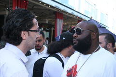 Rick Ross hanging out. Rick Ross talks to a fan at the Sean John Pre-Award Outdoor Jam taking place at the Borracho Cantina in West Hollywood, Ca Royalty Free Stock Image