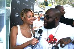 Rick Ross and model/host Bracha Krueger #3 Stock Image
