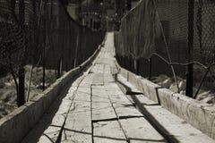 Rickety bridge. The abandon rickety suspension bridge Royalty Free Stock Photography