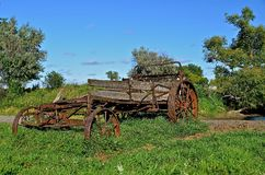 Rickety Manure Spreader. An old rickety manure spreader is parked out in a pasture Royalty Free Stock Photo