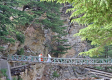 Rickety mountain  bridge over deep gorge Royalty Free Stock Photos