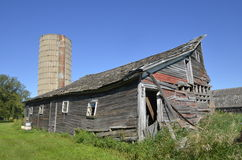 Rickety old barn falling apart Stock Images
