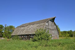 Rickety old barn hip-roofed barn Stock Images