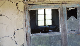 Rickety old wooden window frame with broken window pane. Stock Images