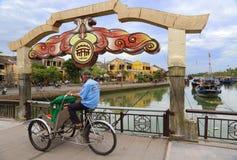 Rickshaw crossing the Hoi An bridge Royalty Free Stock Photo