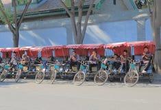 Rickshaw driver Beijing China tourism. Rickshaw drivers wait for passengers in Houhai lake Futong street in Beijing China royalty free stock images