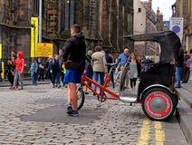 Rickshaw driver from Edinburgh. Royalty Free Stock Image