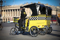 Rickshaw driver in Paris, France Stock Photography