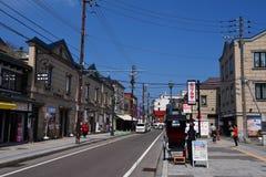Rickshaw driver at Sakaimachi Street, Otaru. OTARU, HOKKAIDO, JAPAN - APRIL 21, 2016: Unidentified rickshaw driver wait for customers at Sakaimachi Street, an Royalty Free Stock Photos