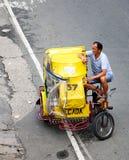 A rickshaw driver on street at Baclaran city in Manila, Philippines Royalty Free Stock Photos