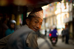 A Rickshaw driver on the streets of Kathmandu, Nepal Royalty Free Stock Images