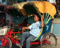 Rickshaw Driver in Taiwan Takes a Nap stock photos