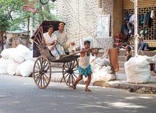Rickshaw driver working in Kolkata, India Royalty Free Stock Photography