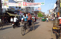 Rickshaw driver working on the street of Indian city Stock Photo