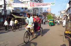 Rickshaw driver working on the street of Indian city Stock Image