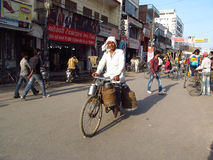 Rickshaw driver working on the street of Indian city Stock Photos
