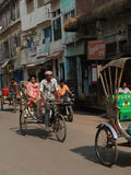 Rickshaw drivers carry local passengers Stock Photo
