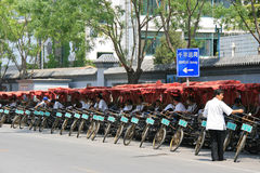 Rickshaw drivers are resting in the street (China). Stock Photo