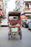 Rickshaw. A Rickshaw goes through a narrow street in Delhi, India Royalty Free Stock Images