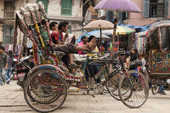 Rickshaw. KATHMANDU, NEPAL – CIRCA OCTOBER 2013: rickshaw is a very popular means of public transport in cities in Nepal circa October 2013 in Kathmandu Royalty Free Stock Photo