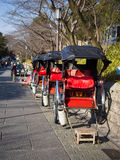 Rickshaw @ Kyoto, Japan. Traditional rickshaws parked on a paved street of Kyoto, Japan waiting for paying passengers. Image taken on 11/03/2014 Stock Image